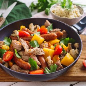 Кус кус с свининой, колбасками и овощами